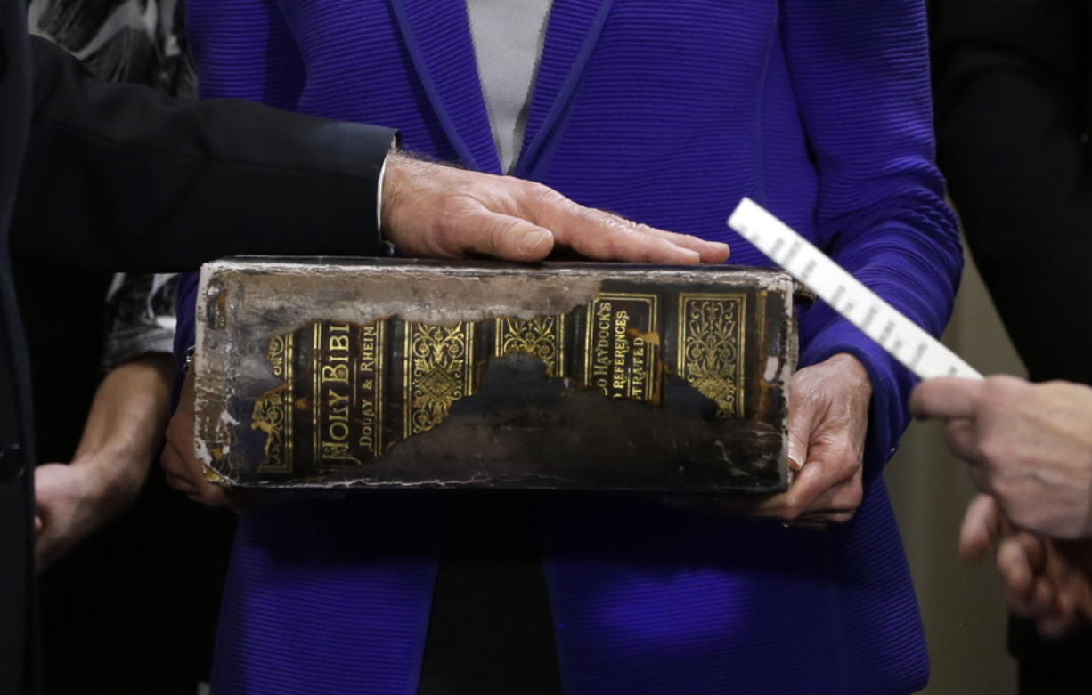 """FILE - In this Sunday, Jan. 20, 2013 file photo, Vice President Joe Biden, left, places his hand on the Biden family Bible held by his wife, Jill Biden, center, as he takes the oath of office from Supreme Court Justice Sonia Sotomayor, right, during an official ceremony at the Naval Observatory in Washington. While many presidents have used Bibles for their inaugurations, the Constitution does not require the use of a specific text and specifies only the wording of president's oath. That wording also doesn't include the phrase """"so help me God,"""" but every modern president has appended it to their oaths and most have chosen symbolically resonant Bibles for their inaugurations."""