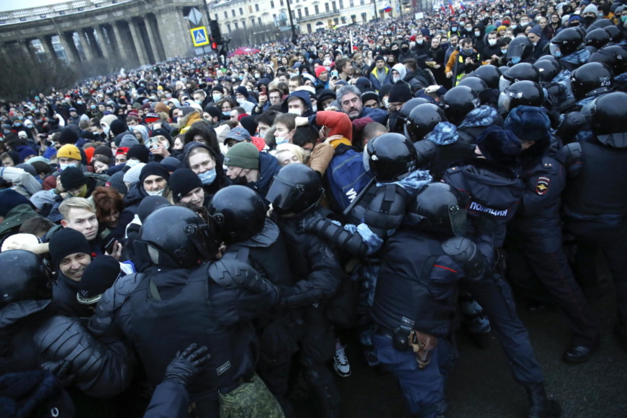 People clash with police during a protest against the jailing of opposition leader Alexei Navalny Saturday in St.