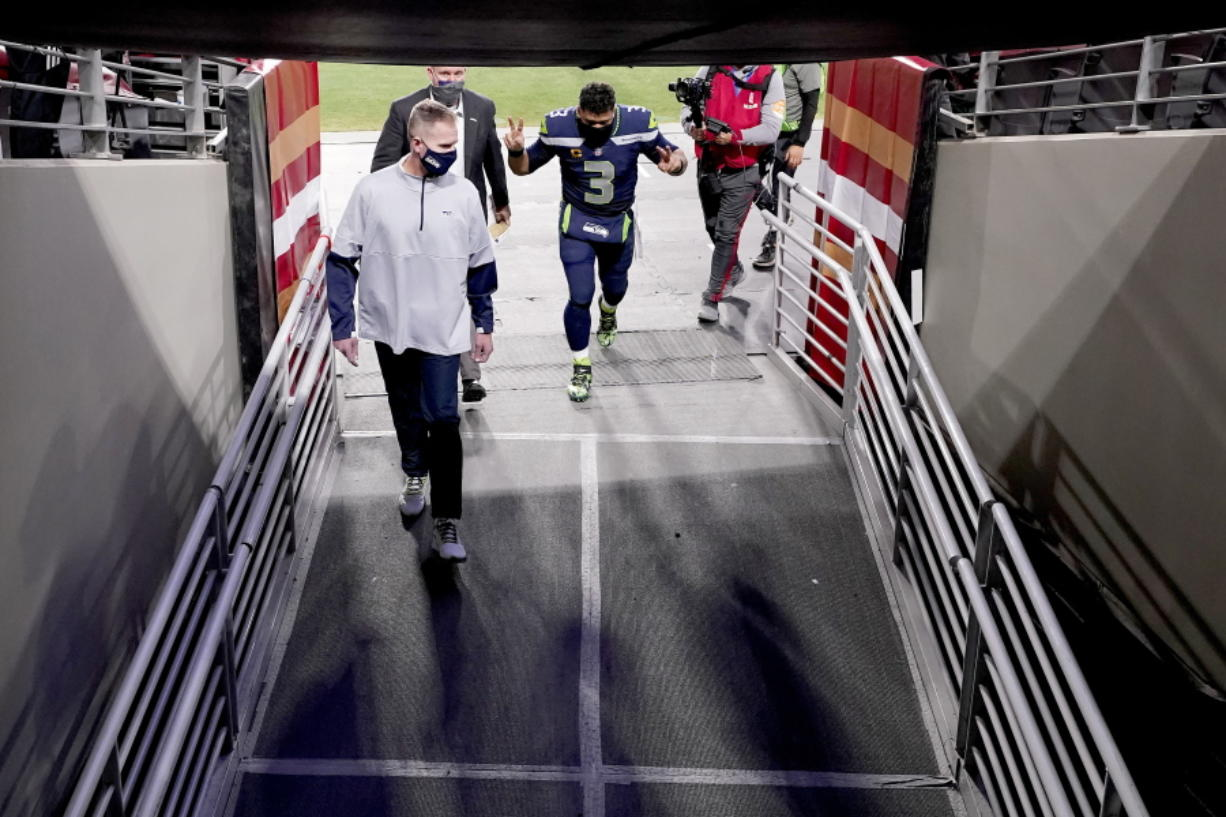 Seattle Seahawks quarterback Russell Wilson (3) leaves the field after a 26-23 win over the San Francisco 49ers. (Ross D.