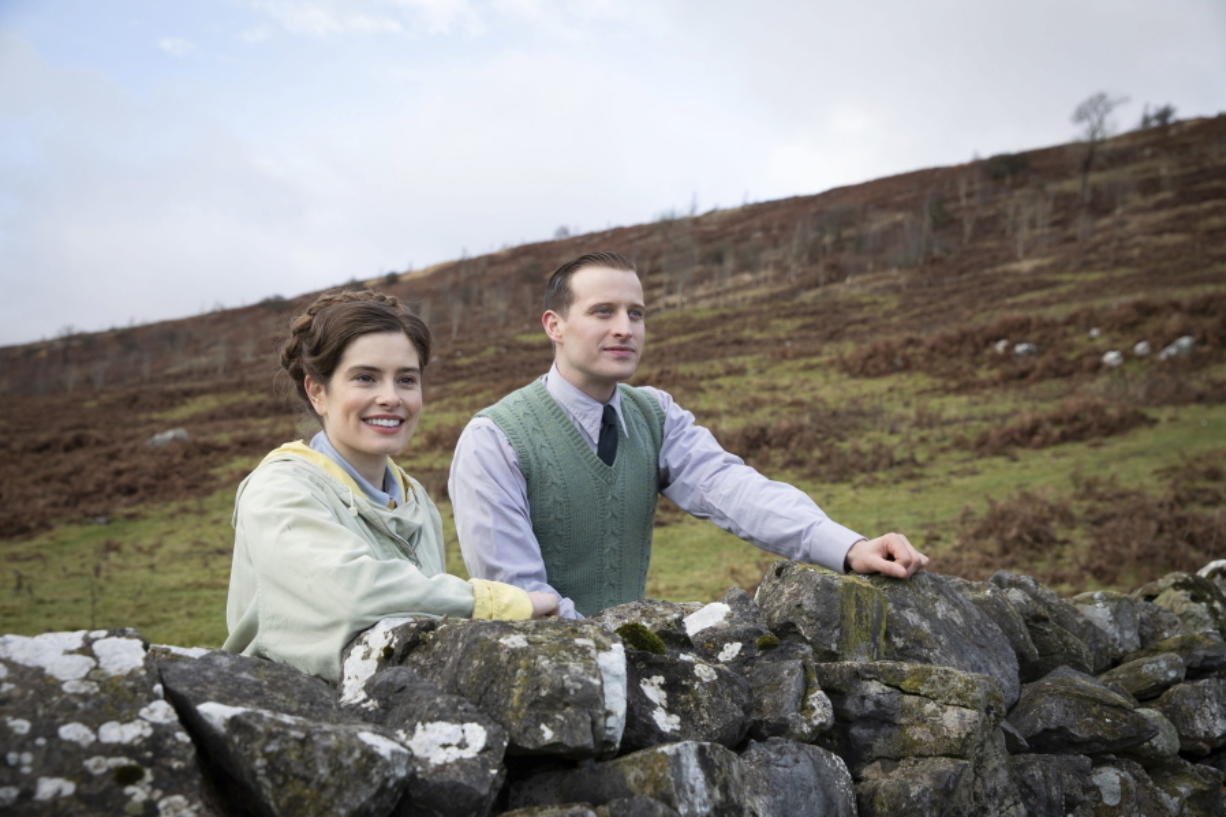 """This image released by PBS shows Rachel Shenton and Nicholas Ralph, right, in a scene from """"All Creatures Great and Small on MASTERPIECE."""" The seven-part series based on James Herriot's adventures as a veterinarian in 1930's Yorkshire premieres on Sunday."""