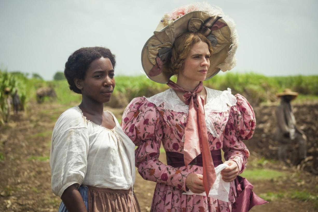 "This image released by PBS shows Tamara Lawrance, left, and Hayley Atwell in a scene from the miniseries ""The Long Song"" debuting Jan."