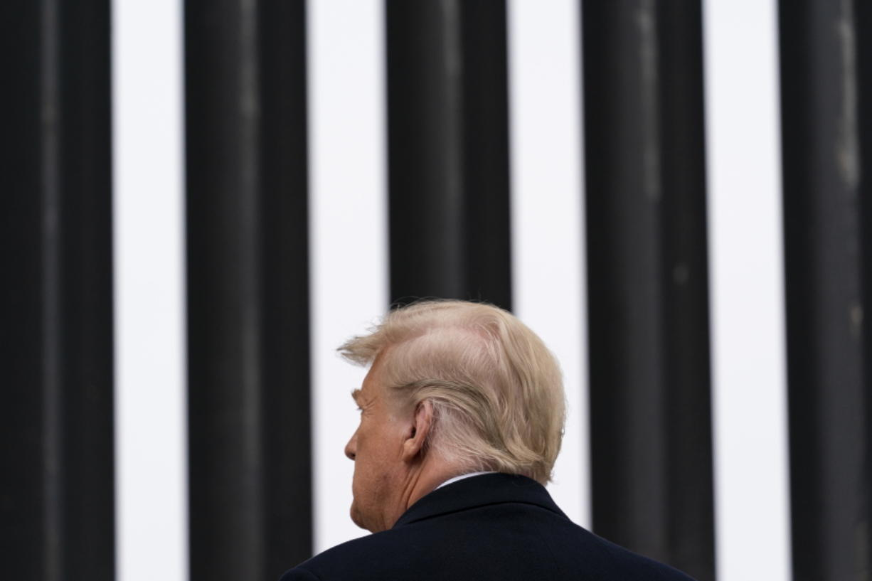 President Donald Trump tours a section of the U.S.-Mexico border wall, Tuesday, Jan. 12, 2021, in Alamo, Texas.