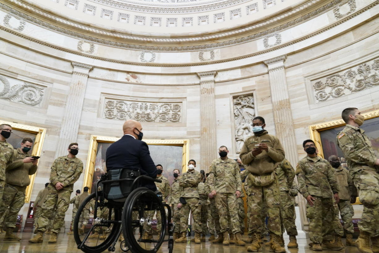 Rep. Brian Mast, R-Fla., gives troops a tour in the Rotunda on Capitol Hill in Washington, Wednesday, Jan. 13, 2021.