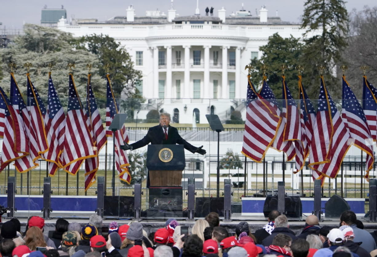 FILE - In this Jan. 6, 2021, file photo with the White House in the background, President Donald Trump speaks at a rally in Washington.