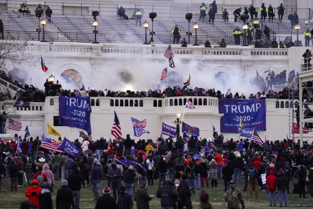 FILE - In this Jan. 6, 2021, file photo violent rioters, loyal to President Donald Trump, storm the Capitol in Washington. The words of Donald Trump supporters who are accused of participating in the deadly U.S. Capitol riot may end up being used against him in his Senate impeachment trial as he faces the charge of inciting a violent insurrection.