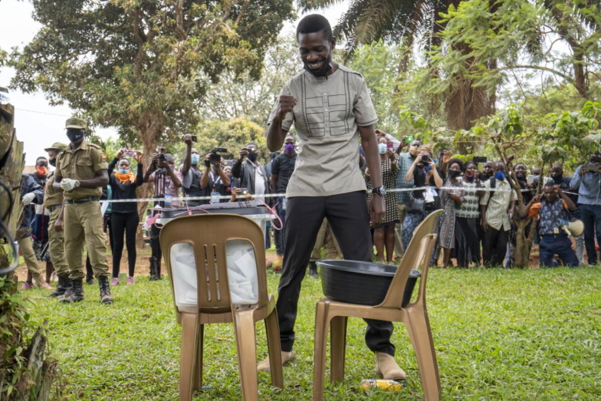 Uganda's leading opposition challenger Bobi Wine reacts after voting in Kampala, Uganda, Thursday, Jan. 14, 2021.