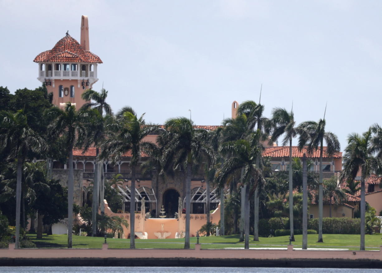 FILE - President Donald Trump's Mar-a-Lago estate is shown in a Wednesday, July 10, 2019 file photo, in Palm Beach, Fla. A Florida legislator wants President Donald Trump's Mar-a-Lago club punished for hosting a New Year's Eve party where few of the 500 guests wore masks in possible violation of local coronavirus ordinances. Democratic state Rep. Omari Hardy said Monday, Jan. 4, 2021 that Palm Beach County must take action against Mar-a-Lago out of fairness both to local businesses that have obeyed the ordinance and those punished for violating it.