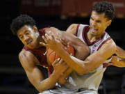 Washington State center Dishon Jackson, left, wrestles for the ball with Stanford forward Oscar da Silva during the second half of an NCAA college basketball game in Santa Cruz, Calif., Saturday, Jan. 9, 2021.