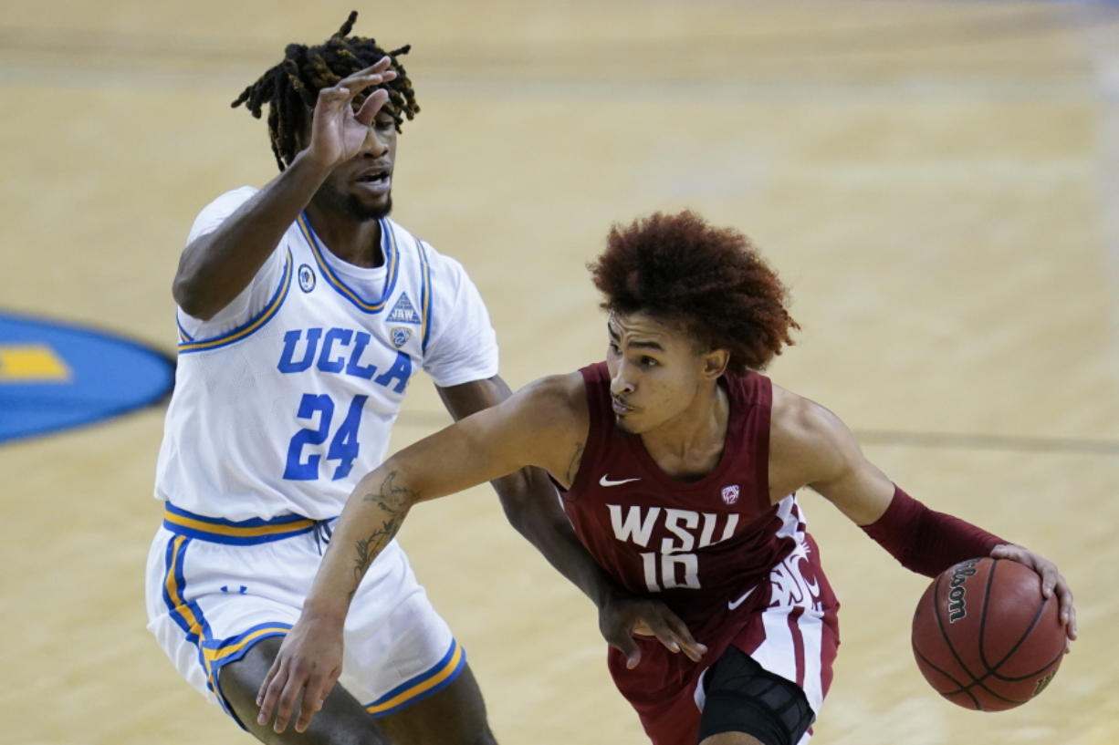 UCLA forward Jalen Hill (24) defends against Washington State guard Isaac Bonton (10) during the first quarter of an NCAA college basketball game Thursday, Jan. 14, 2021, in Los Angeles.