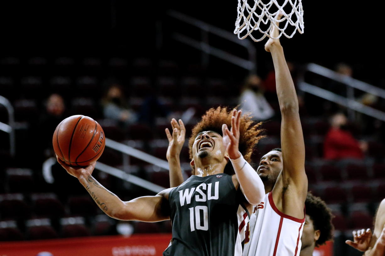Washington State guard Isaac Bonton (10) goes up to basket under pressure from Southern California forward Evan Mobley (4) during the second half of an NCAA college basketball game Saturday, Jan. 16, 2021, in Los Angeles. (AP Photo/Ringo H.W.