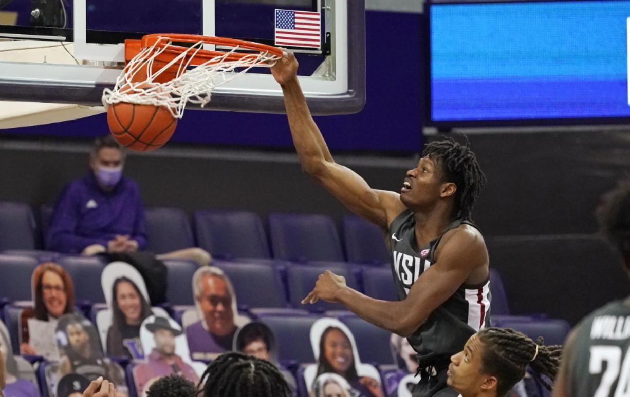 Washington State's Efe Abogidi dunks against Washington in the first half of an NCAA college basketball game Sunday, Jan. 31, 2021, in Seattle.