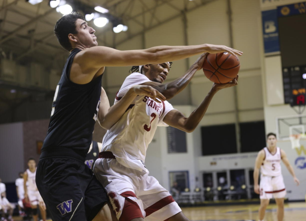 Washington center Riley Sorn (52), left, defends a shot against Stanford forward Ziaire Williams (3) during the first half of an NCAA college basketball game in Santa Cruz, Calif., Thursday, Jan. 7, 2021.