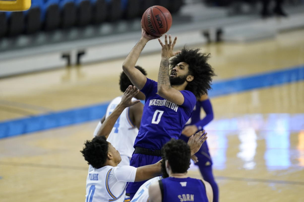 Washington guard Marcus Tsohonis (0) takes a shot against UCLA guard Jaylen Clark (0) during the first half of an NCAA college basketball game Saturday, Jan. 16, 2021, in Los Angeles.