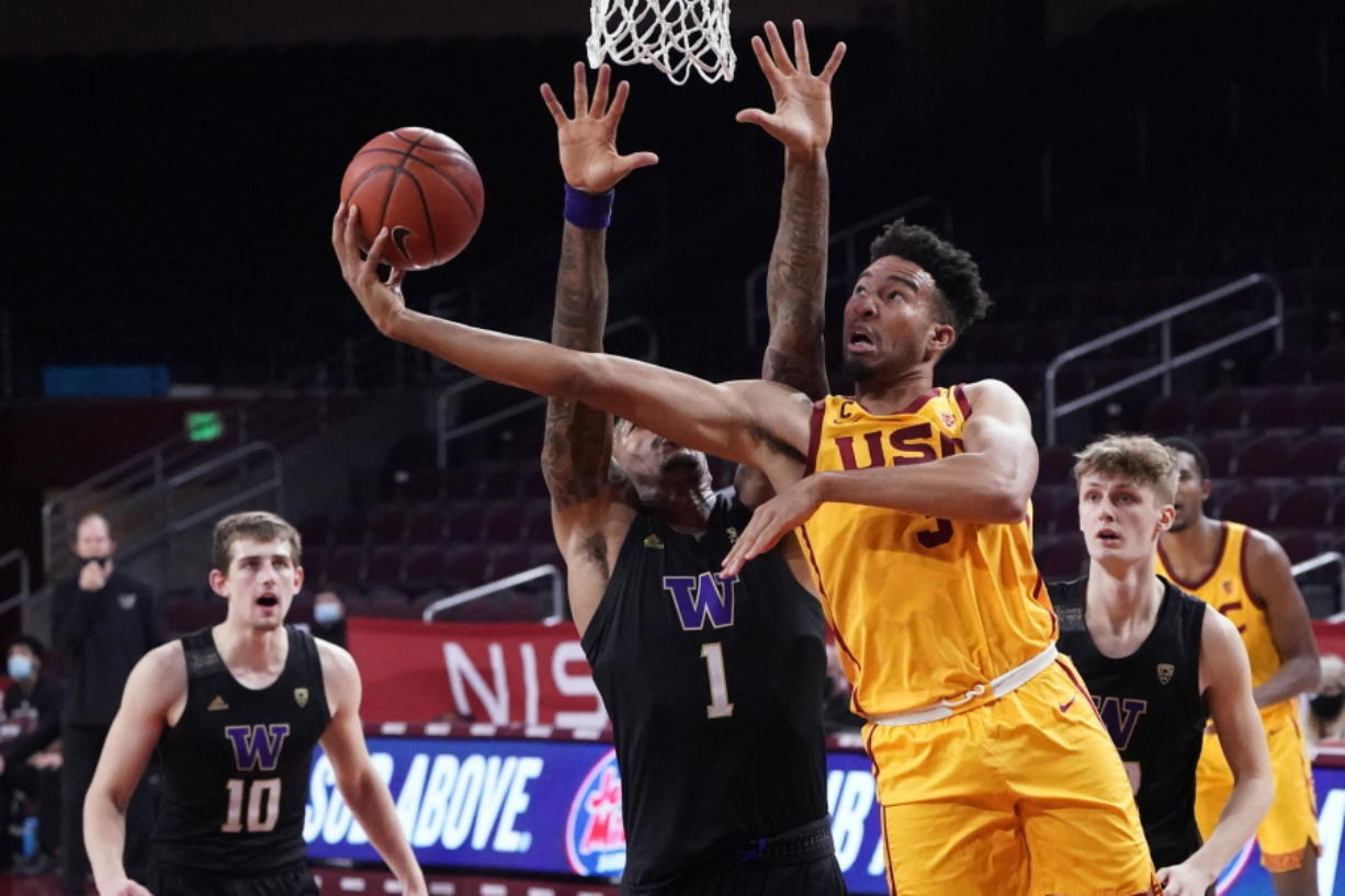 Southern California forward Isaiah Mobley, right, scores over Washington forward Nate Roberts (1) during the second half of an NCAA college basketball game Thursday, Jan. 14, 2021, in Los Angeles.