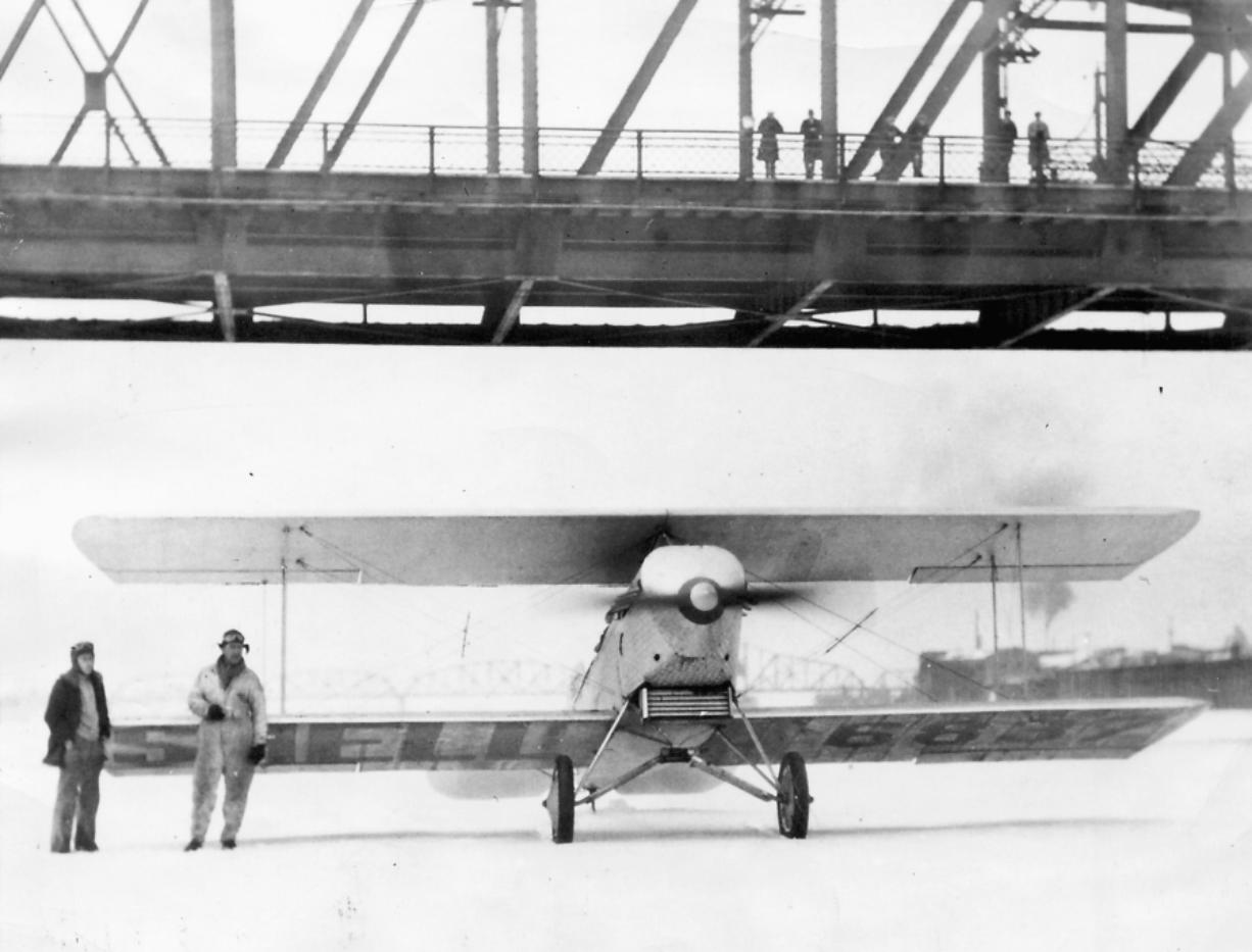 Clarence Murray made the iced-over river a landing strip for an American Eagle, 90 horsepower biplane on Jan. 31, 1930. Celebrating their landing, a photographer captured Murray, right, and his son, Glenn, standing on the frozen Columbia River. This was the last time the river froze over.