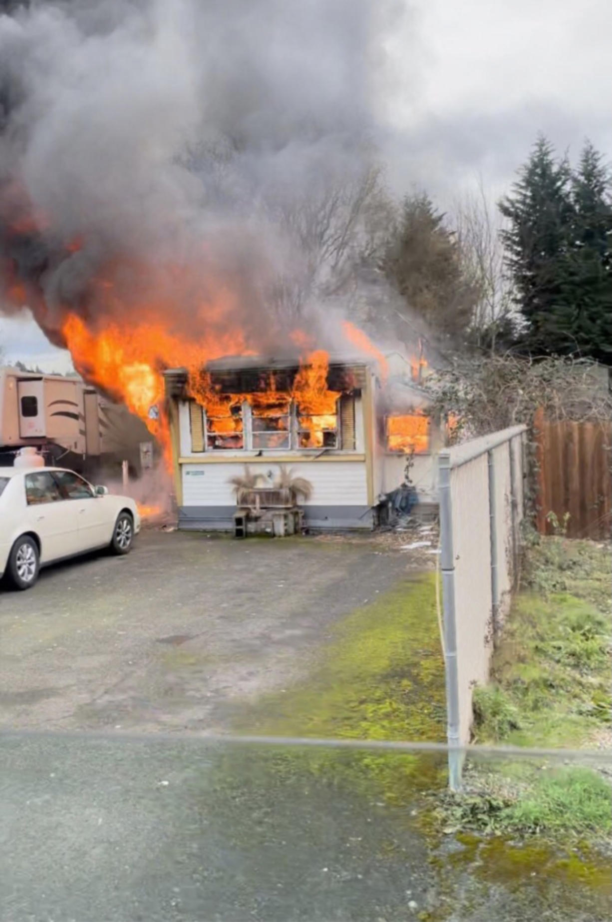 Two people were injured in a mobile home fire Saturday afternoon after a propane tank exploded inside the residence in Vancouver's Rose Village neighborhood.