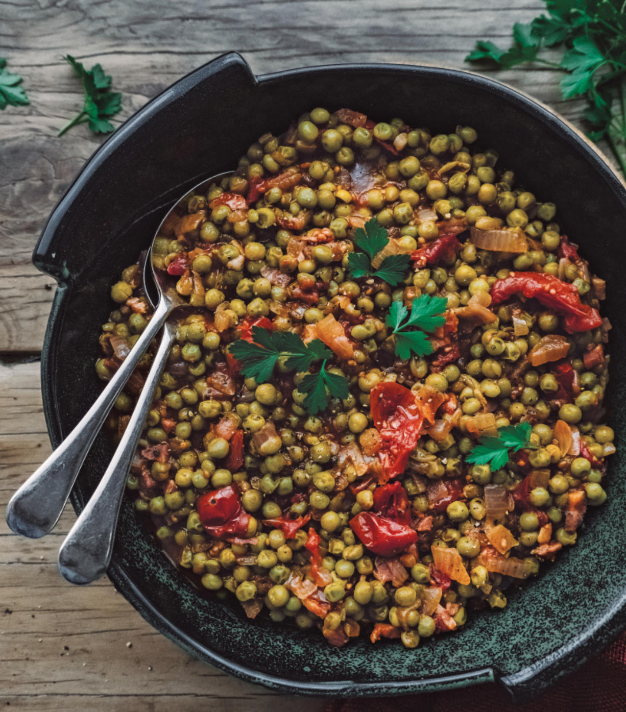 """Piselli (braised peas in tomato) from """"Frugal Mediterranean Cooking"""" by Melanie Lionello."""