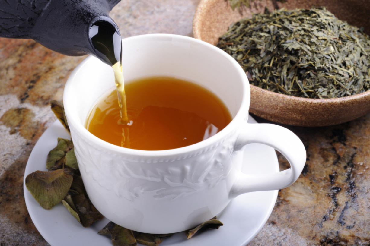 Drinking at least seven cups of green tea or one cup of coffee daily can lower the risk of death in those who've had a heart attack or stroke, according to researchers in Japan.