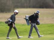 Senior Owen Huntington, left, and sophomore Eli Huntington are enjoying one last run as teammates on a talented Camas boys golf team.