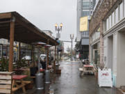 Customers take shelter in an outdoor dining area of Little Conejo in downtown Vancouver. Declining COVID-19 activity has allowed Clark County to move into Phase 2 of the state's reopening plan, which will allow indoor dining, with restrictions, to resume on Monday.