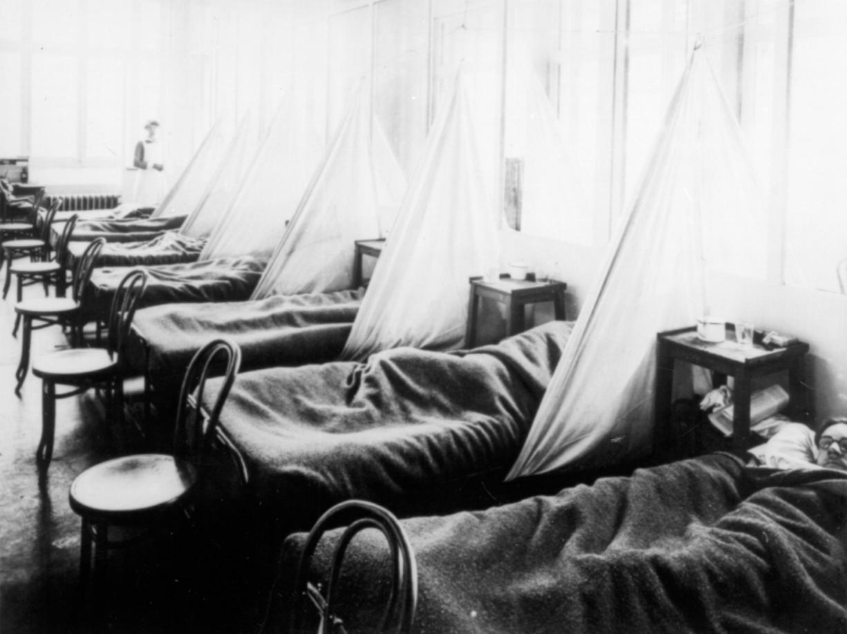 Influenza  patients lie on cots at the U.S. Army Camp Hospital #45, Aix-les-Bains, France during the 1918 Spanish influenza outbreak. Public health officials are so worried about a flu pandemic, like the 1918 killer of 20 million people worldwide, that they are preparing localized response plans just as they do for hurricanes and earthquakes.