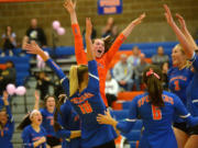 The Ridgefield volleyball team celebrates a win against Columbia River last season. The Spudders open their 2020-21 season at home Tuesday against Mark Morris.