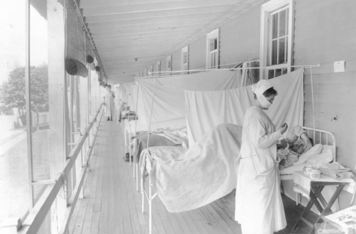 A nurse takes the pulse of a patient in the influenza ward of the Walter Reed hospital in Washington in November 1918. According to the Centers for Disease Control and Prevention, the number of U.S. deaths from the Spanish flu pandemic was estimated to be about 675,000.