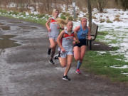 Washougal freshman Elle Thomas runs ahead of Hockinson senior Allyson Peterson and Washougal sophomore Sydnee Boothby during a 5,000 meter race Thursday at Hockinson Meadows Community Park. Thomas won in 18 minutes, 57 seconds.