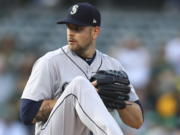 James Paxton, pitching here for the Mariners in 2018, has been brought back to Seattle on a one-year deal worth $8.5 million.