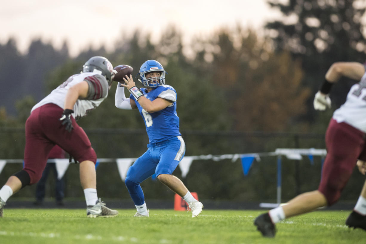 La Center quarterback Tom Lambert (6) passed for 1,252 yards and 12 touchdowns and also rushed 808 yards and 15 TDs for the Wildcats in 2019.