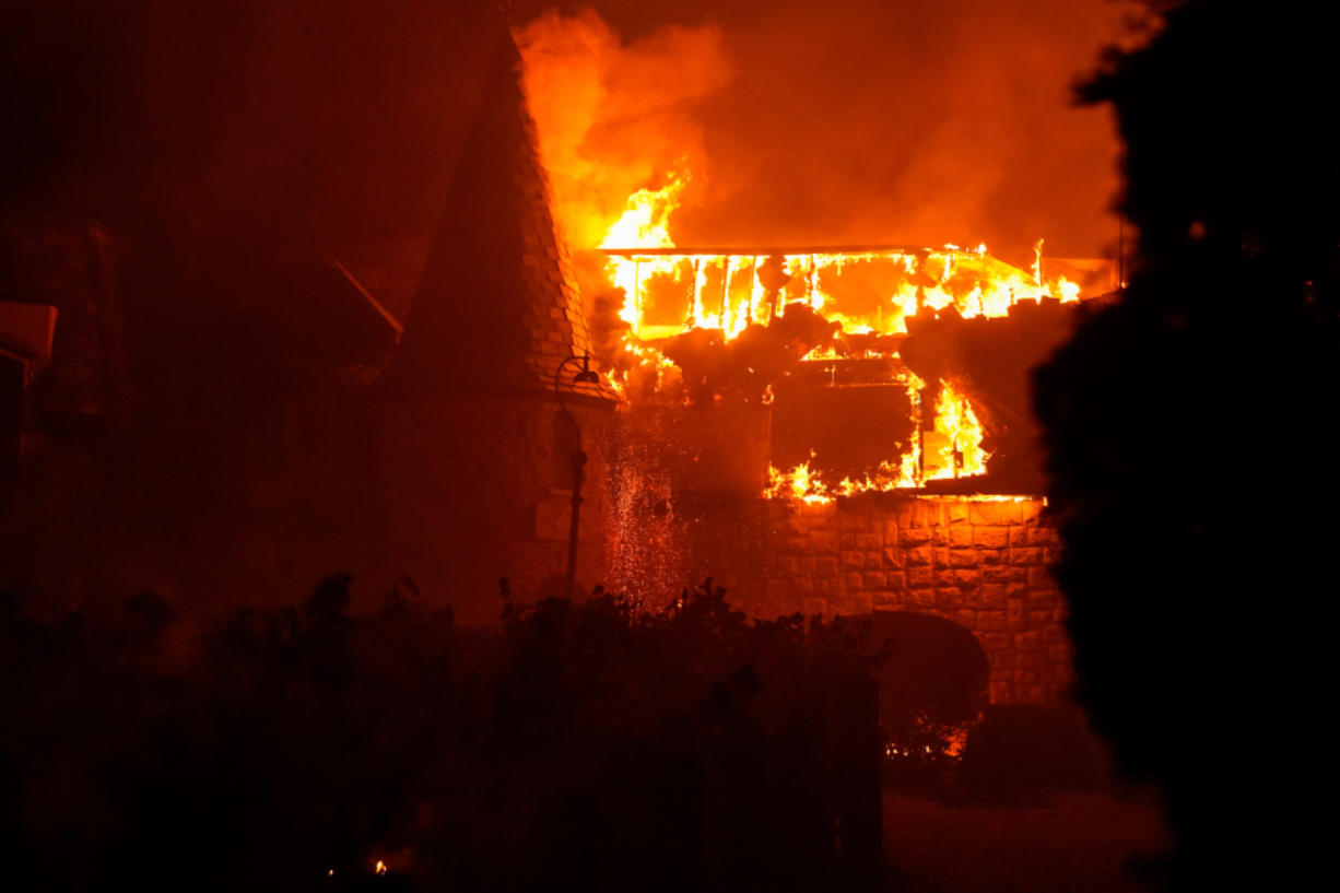 The Glass Fire burns along Silverado Trail in Napa County near the Chateau Boswell Winery on Sept. 27 in St. Helena, Calif.