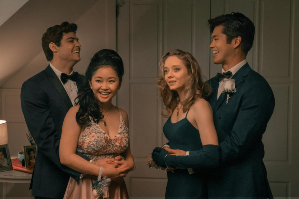 """Noah Centineo as Peter Kavinsky, from left, Lana Condor as Lara Jean Covey, Madeleine Arthur as Christine and Ross Butler as Trevor in """"To All the Boys: Always and Forever."""" (Katie Yu/Netflix)"""