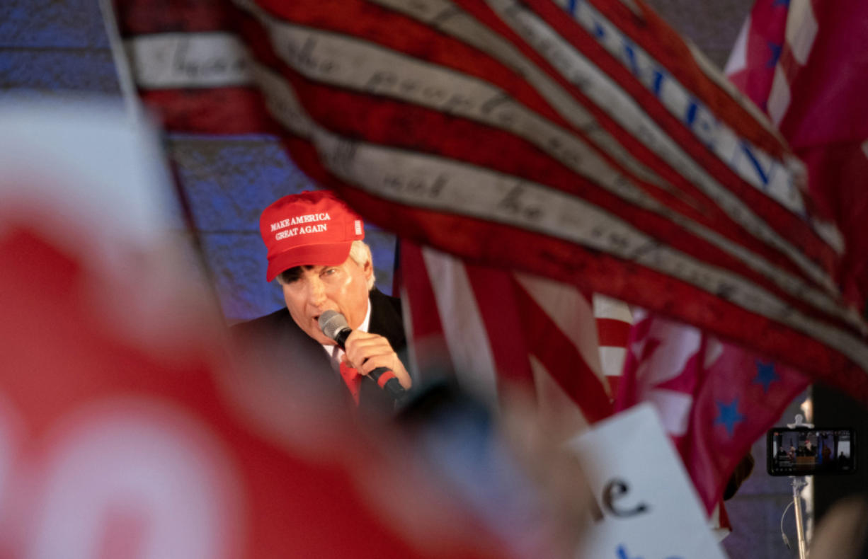 """Attorney L. Lin Wood addresses supporters of President Donald Trump during a """"Stop the Steal"""" rally in Alpharetta, Ga., on Dec. 2, 2020."""
