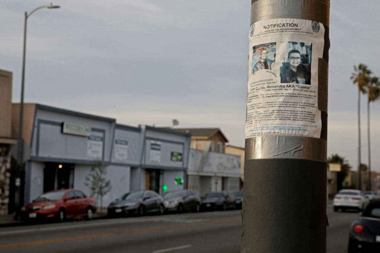 A Los Angeles Police Department missing person notification for Juan Carlos Hernandez hangs across the street from where he worked at VIP Collective marijuana dispensary along the 8100 block of Western Ave. Yajaira Hernandez's 21-year-old son, Juan Carlos Hernandez, went to work one afternoon in September 2020 and never came home, on Wednesday, Feb. 3, 2021 in Los Angeles, CA. She looked for her son for nearly two months, until the police told her they'd found his remains in the Mojave desert, 150 miles from where he was last seen at his job at a marijuana dispensary in South Los Angeles.