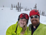 Kelly and Edward Moellmer smile during a backcountry skiing trip in 2020.