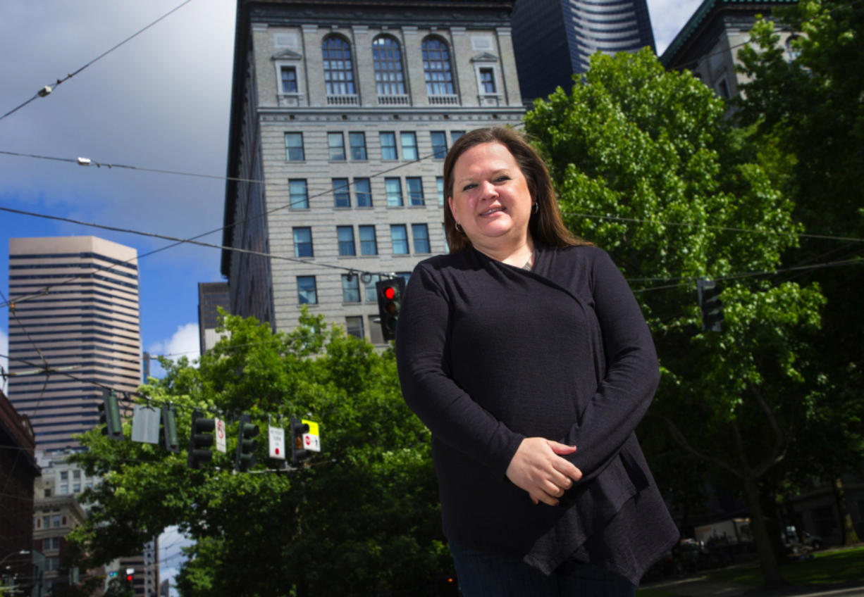 Washington state Rep. Tarra Simmons, a Bremerton Democrat, backs a bill that would allow formerly incarcerated people to work in health care and in-home care jobs. Simmons stands near the King County Courthouse in downtown Seattle on June 1, 2018.