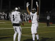 Union running back Jaydon Jones, right, celebrates a score against Camas with teammate Jake Bowen, left.