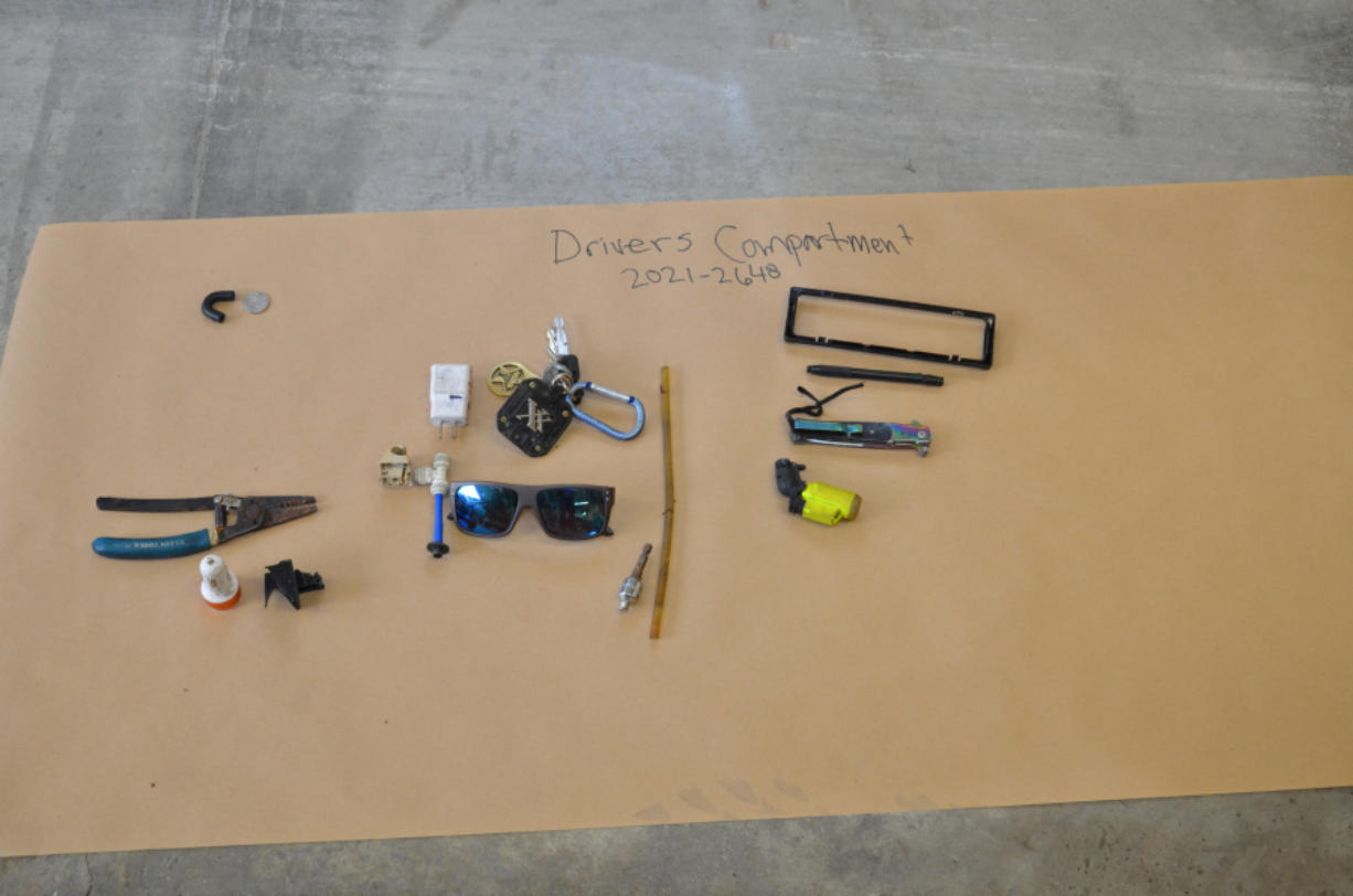 Photographs released Friday by the Vancouver Police Department -- which is leading the Jenoah Donald shooting investigation and handling the release of information -- show items found during a search of Donald's Mercedes-Benz earlier this month.