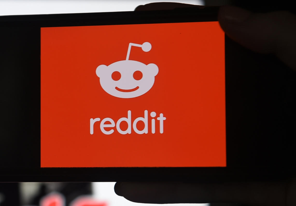 This photo illustration shows the logo of Reddit on a mobile phone in Arlington, Virginia, on January 29, 2021.