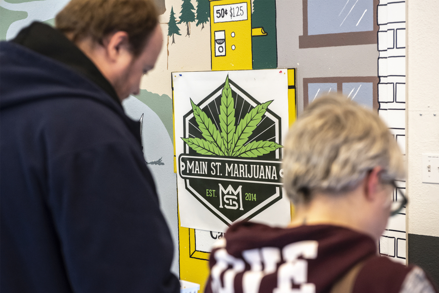 A poster for Main Street Marijuana is seen here on the dispensaryis wall in Vancouver on Tuesday afternoon, Feb. 4, 2020.