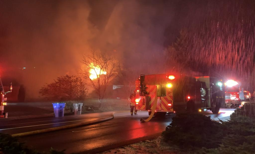 Vancouver firefighters on the scene of a house fire Thursday night on Southeast McGillivray Boulevard.