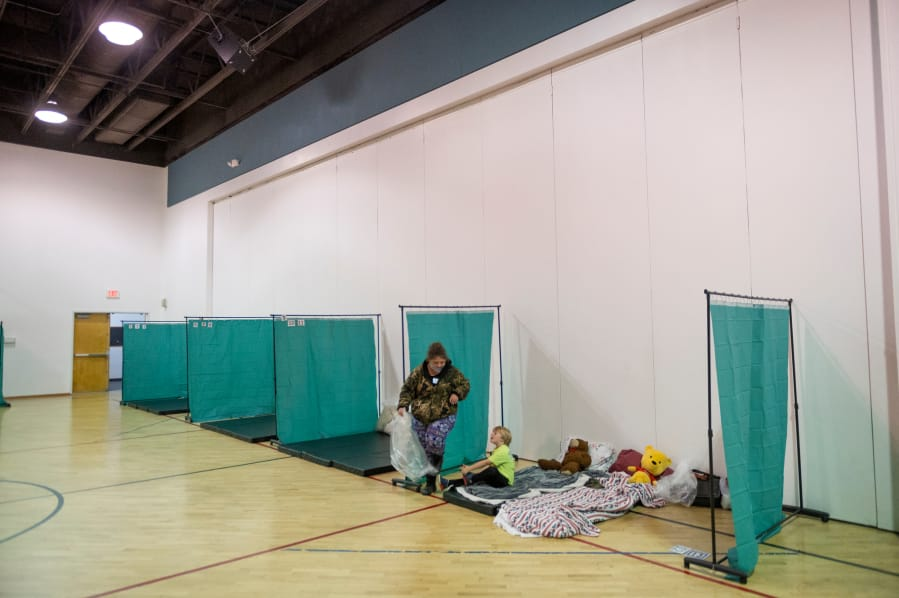 Homeless shelters in Clark County will expand to help the homeless as a winter storm approaches — despite the pandemic.