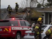 Firefighters respond to a blaze in two units at the Logan's Court duplex complex in Vancouver's Lincoln neighborhood on Monday afternoon, Feb. 22, 2021.