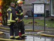 Firefighters work at the scene of a fire at Logan's Court duplex complex in Vancouver's Lincoln neighborhood on Monday afternoon, Feb. 22, 2021.