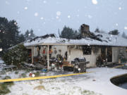 A Feb. 11 house fire, in which the home's roof collapsed, was caused by an electrical malfunction or failure of the microwave range, according to the Vancouver Fire Marshal's Office.