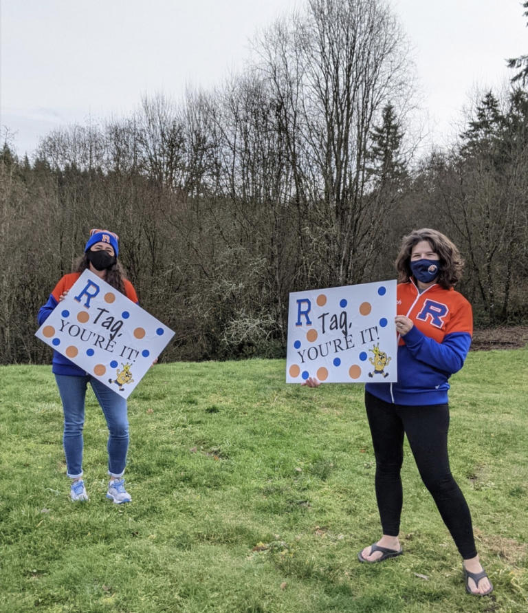 RIDGEFIELD: Cheerleading coaches Alyssa Tomillo and Anja Felton kicked off the game of yard sign tag.