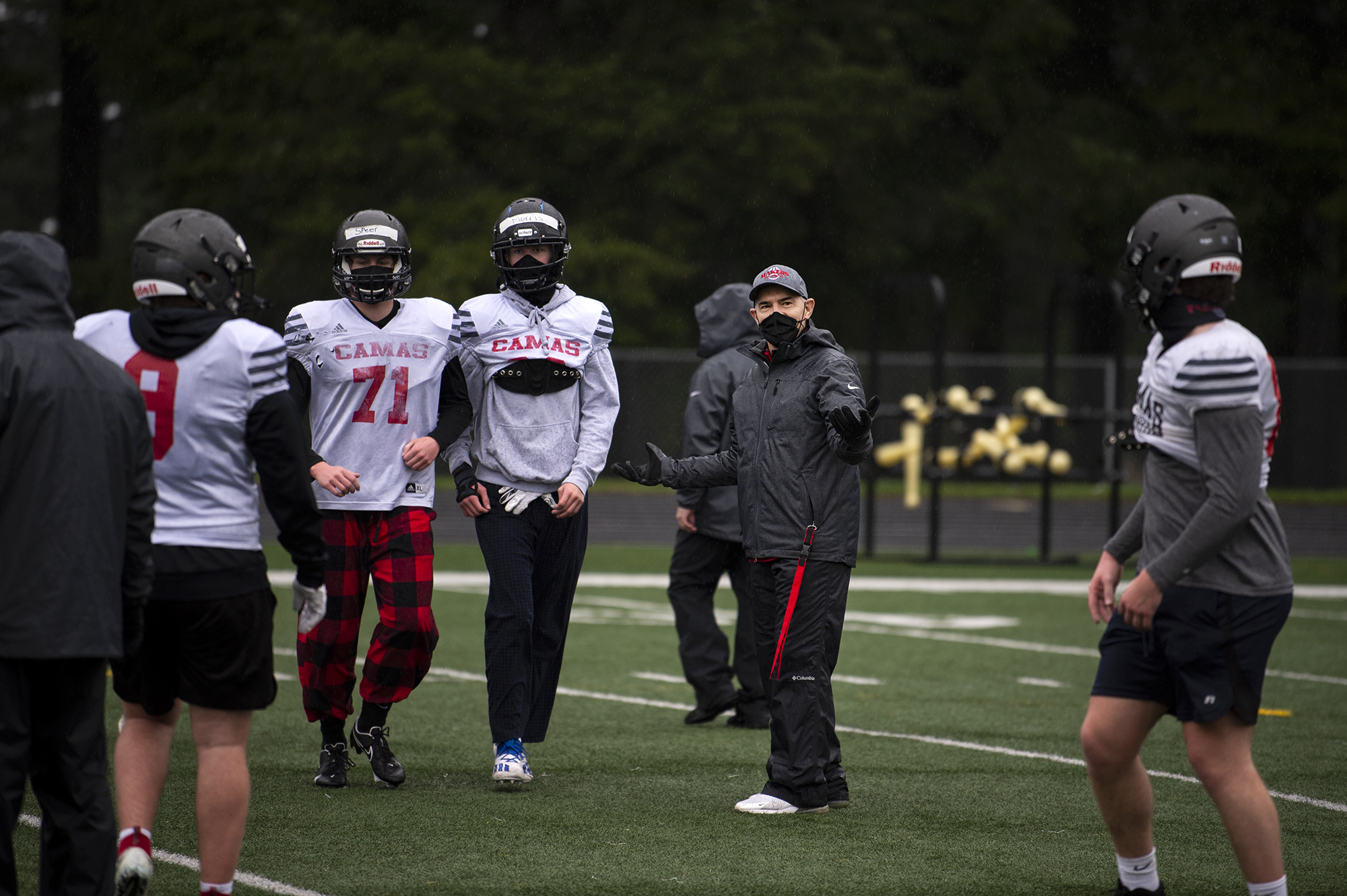 Camas coach Jon Eagle tries to walk players through a punt protection drill on Monday, February 1, 2021 at Cardon Field at Camas High School. Eagle's Papermakers won't get a chance to defend their 2019 4A State Championship in a shortened season.