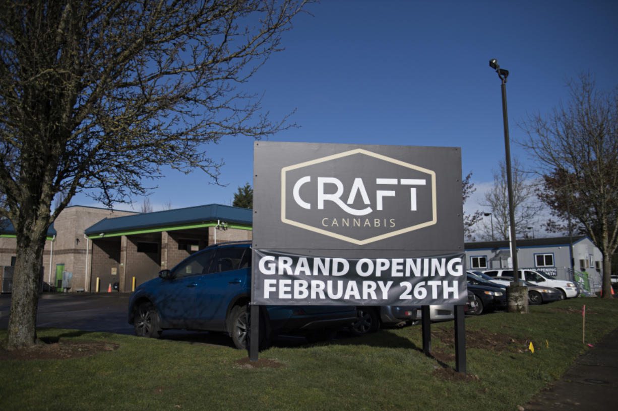 A sign advertises the new Craft Cannabis location in northeast Vancouver. The shop is on a site formerly occupied by a car wash and is operating out of a temporary building. The owners plan to tear down the old car wash building and build a new commercial space for the store.