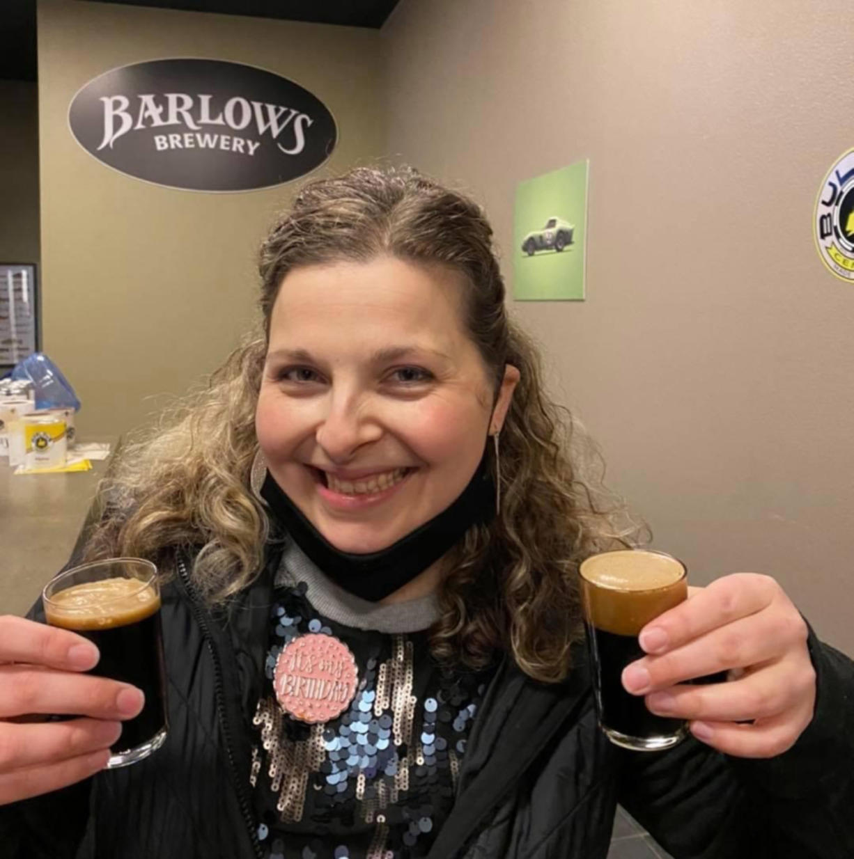 Bria Perozzo with two new dark beers at Barlows Brewery.