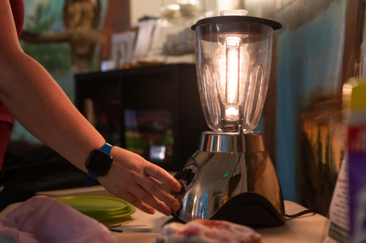 Terra Heilman, Repair Clark County coordinator at Columbia Springs, shows off a blender that has been repurposed as a lamp by a volunteer. She will host a March 1 virtual show-and-tell of upcycled items as part of Clark County's WasteBusters Challenge.
